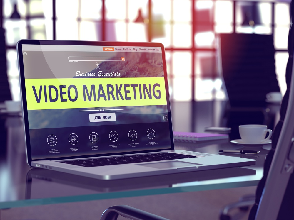 Video Marketing Concept. Closeup Landing Page on Laptop Screen  on background of Comfortable Working Place in Modern Office. Blurred, Toned Image. 3d render.-1