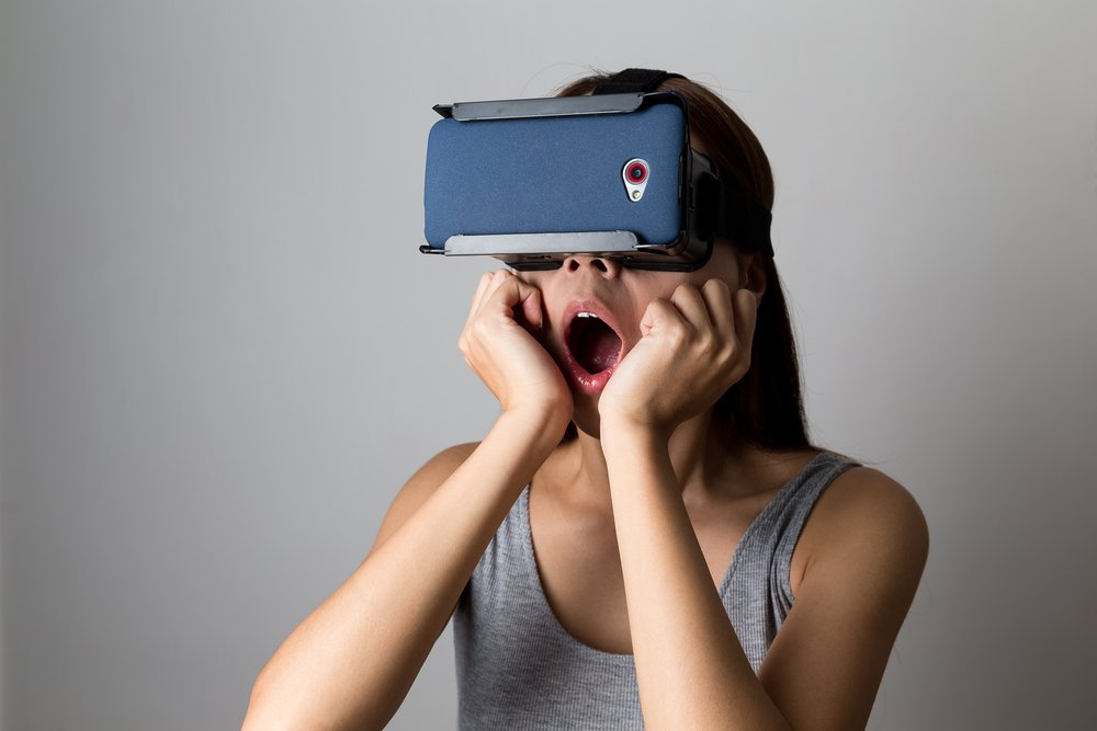 Young Woman feeling shocking for using the virtual reality device